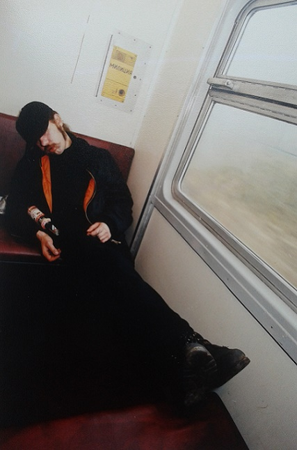 A man sleeping in the electric train